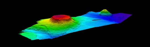 Seamounts are formed as a result of underwater lava eruptions that accumulate material in layers creating an underwater mountin, if the mountain reached the water surface, the tip becomes flat as a result of erosion by waves.